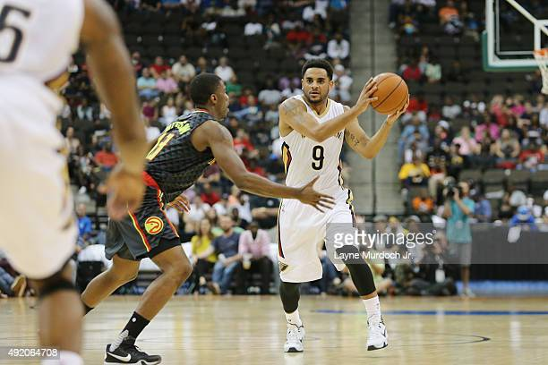 Corey Webster of the New Orleans Pelicans handles the ball against the Atlanta Hawks during a preseason game on October 9 2015 at the Jacksonville...