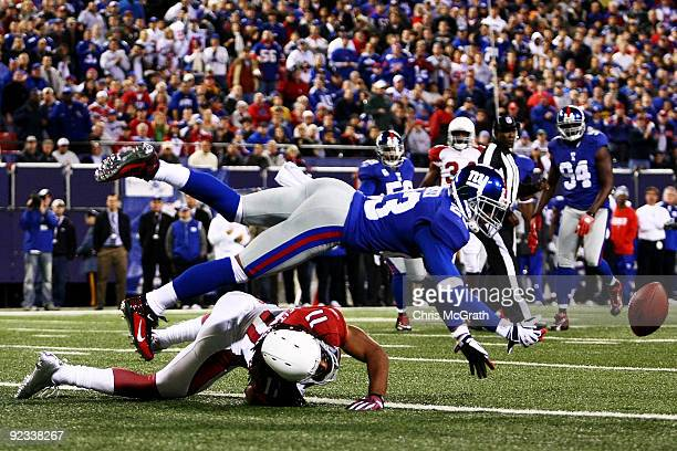 Corey Webster of the New York Giants deflects the ball away from Larry Fitzgerald of the Arizona Cardinals on October 25 2009 at Giants Stadium in...