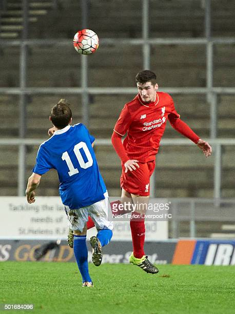 Corey Whelan of Liverpool and Ben Morris of Ipswich Town in action during the Liverpool v Ipswich Town FA Youth Cup game at Langtree Park on December...