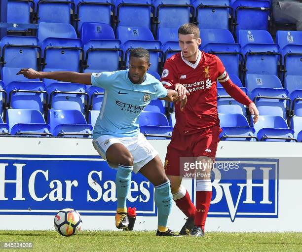 OUT Corey Whelan of Liverpool with Sadou Diallo of Manchester City during the game at Prenton Park on September 10 2017 in Birkenhead England