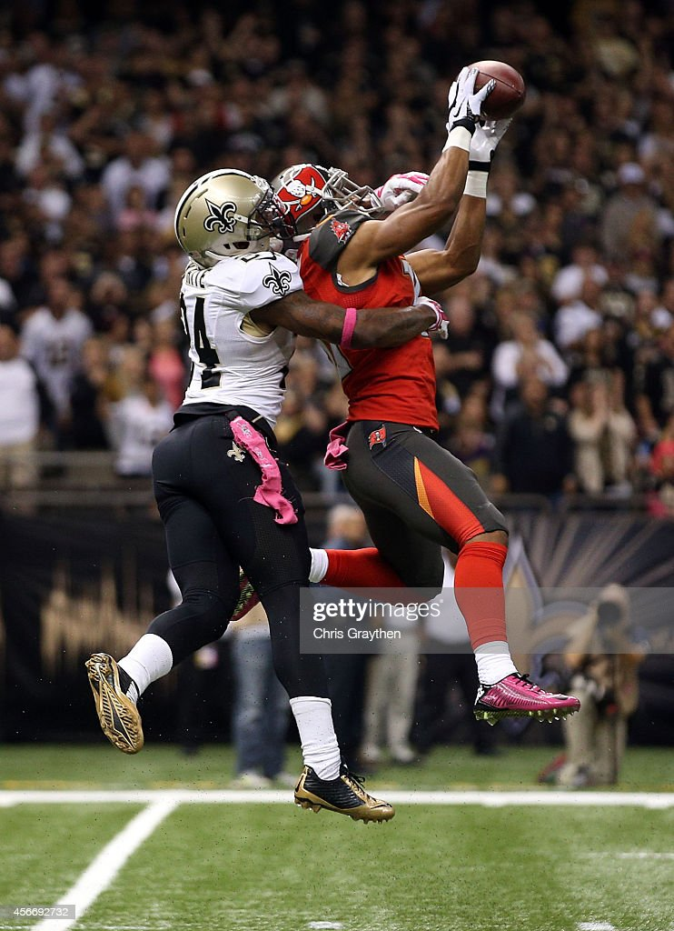 Corey White #24 of the New Orleans Saints defends a pass intended for Robert Herron #10 of the Tampa Bay Buccaneers during the second quarter of a game at the Mercedes-Benz Superdome on October 5, 2014 in New Orleans, Louisiana.