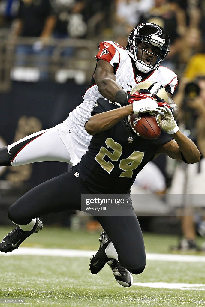 Corey White #24 of the New Orleans Saints intercepts a pass thrown to Drew Davis #19 of the Atlanta Falcons at Mercedes-Benz Superdome on November 11, 2012 in New Orleans, Louisiana. The Saints defeated the Falcons 31-27.