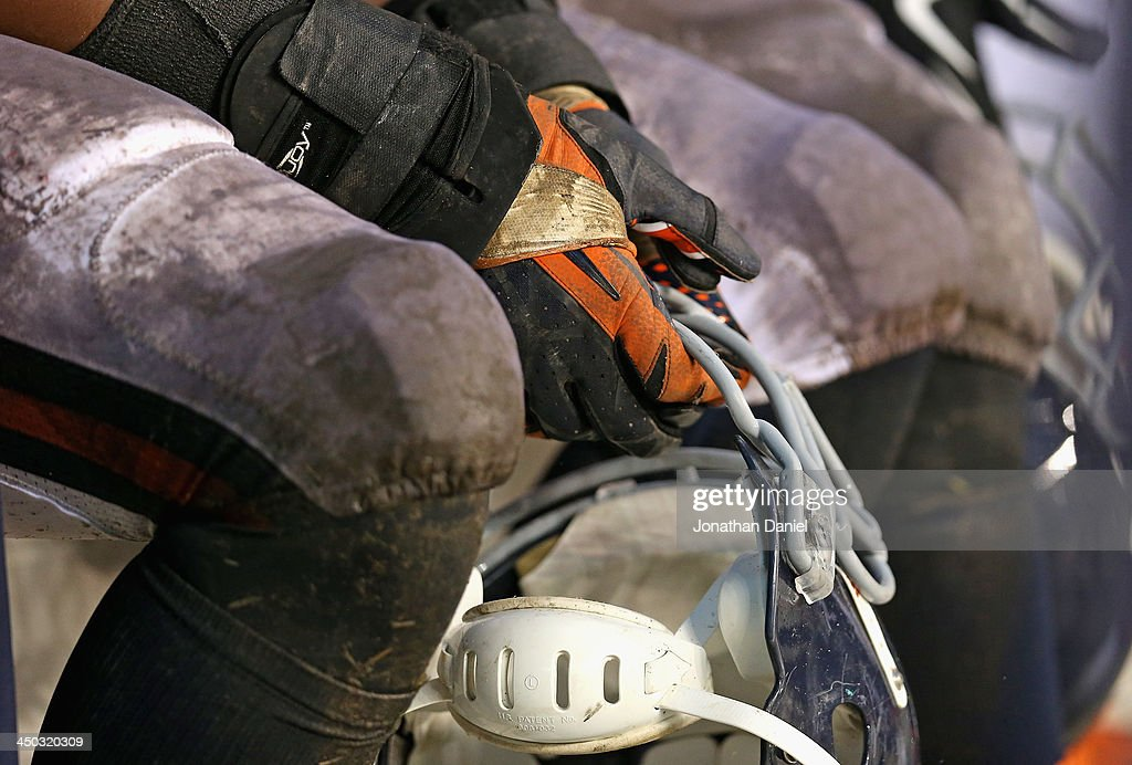 Corey Wootton #98 of the Chicago Bears holds his helmet on the bench during a game against the Baltimore Ravens at Soldier Field on November 17, 2013 in Chicago, Illinois. The Bears defeated the Ravens 23-20 in overtime.
