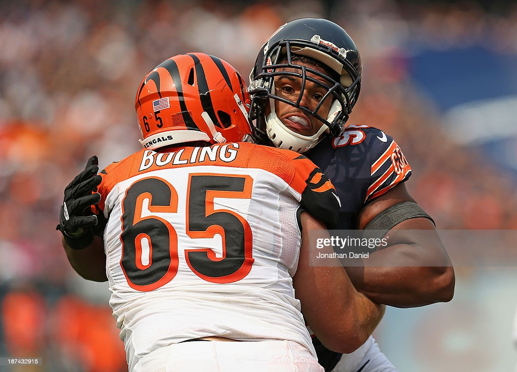Corey Wootton #98 of the Chicago Bears rushes against <a gi-track='captionPersonalityLinkClicked' href=/galleries/search?phrase=Clint+Boling&family=editorial&specificpeople=4524027 ng-click='$event.stopPropagation()'>Clint Boling</a> #65 of the Cincinnati Bengals at Soldier Field on September 8, 2013 in Chicago, Illinois. The Bears defeated the Bengals 24-21.