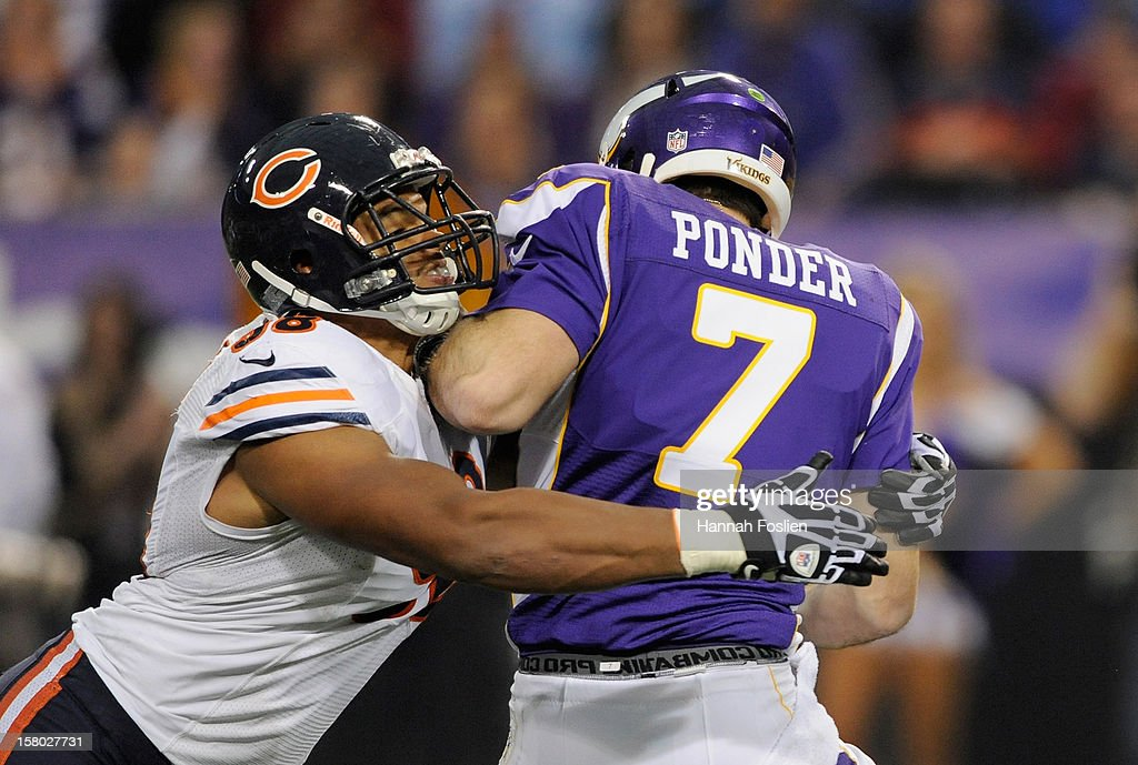 Corey Wootton #98 of the Chicago Bears sacks Christian Ponder #7 of the Minnesota Vikings during the first quarter of the game on December 9, 2012 at Mall of America Field at the Hubert H. Humphrey Metrodome in Minneapolis, Minnesota.