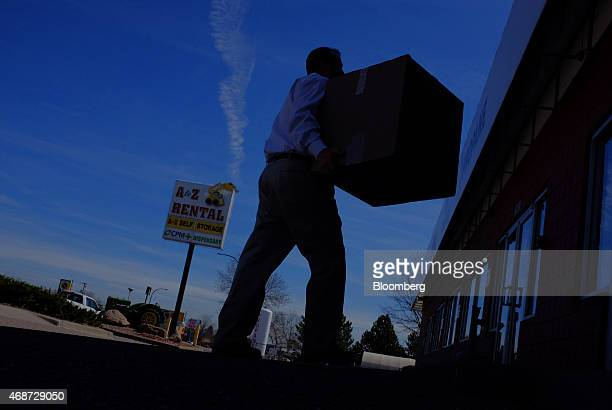 Corey Young a founder of courier service CannaRabbit LLC delivers bags of marijuana to a dispensary in in Lakewood Colorado US on Friday March 27...