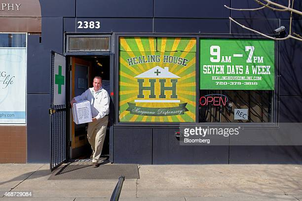 Corey Young a founder of courier service CannaRabbit LLC picks up a delivery of marijuana from a dispensary as part of a wholesale transfer in Denver...