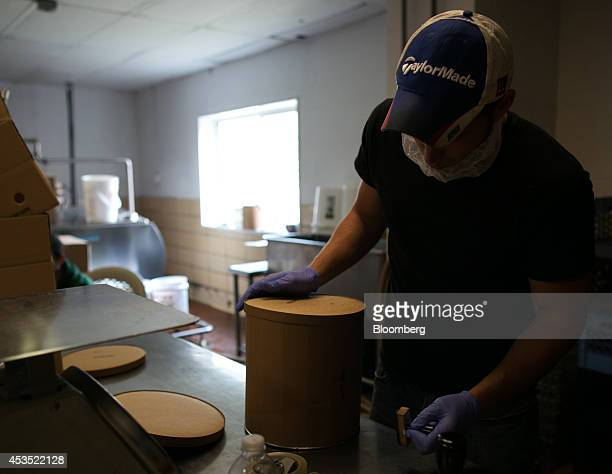 Corey Youngs seals a threegallon tub of Riesling ice cream at Mercer's Dairy in Boonville New York US on Friday July 25 2014 Mercer's Dairy ships its...