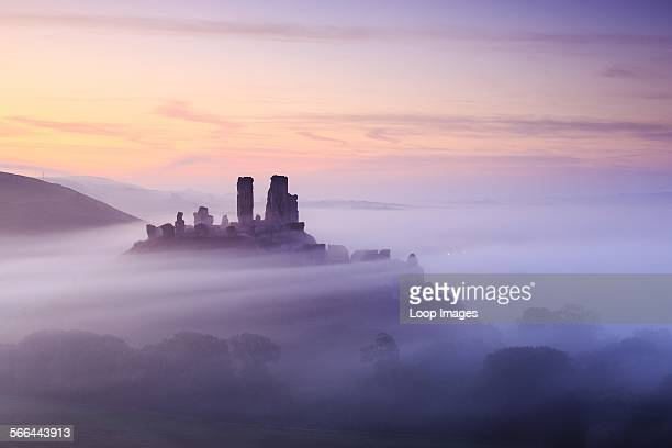 Corfe Castle in Dorset on a misty morning