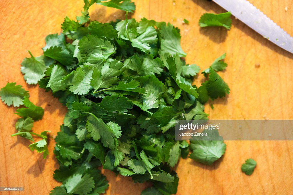 Coriander leaves being finely chopped
