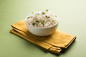 Coriander or cilantro Basmati Rice, served in a ceramic or terracotta bowl. It's a popular Indian OR Chinese recipe. Selective focus