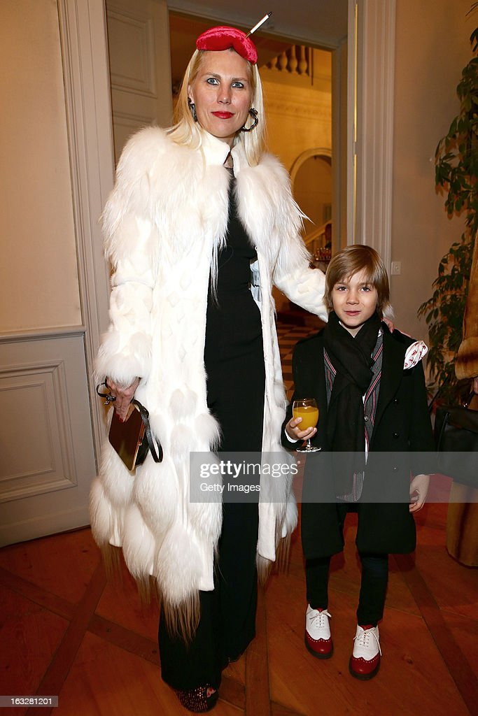 Corina Larpin and her son attend the charity auctioning of the first 'Citroen DS3 Cabrio L'Uomo Vogue' hosted by L'Uomo Vogue and Citroen at the Permanent Mission of France to the United Nations Office on March 6, 2013 in Geneva, Switzerland.