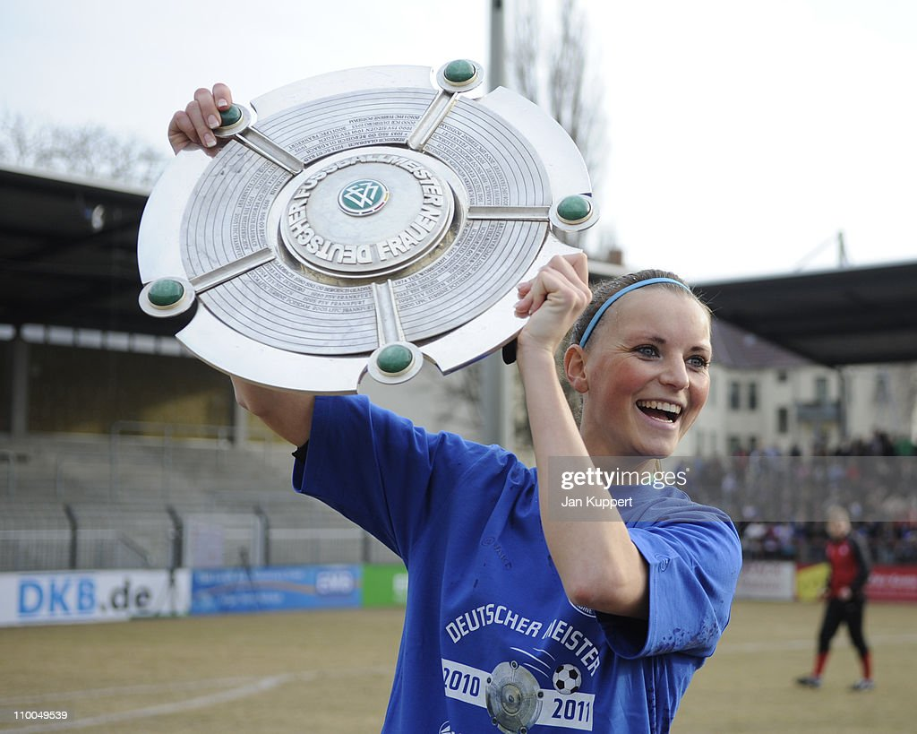 Corina Schroeder holds up the trophy after winning after the Women Bundesliga match between Turbine Potsdam and Essen-Schoenebeck at the Karl-Liebknecht stadium on March 13, 2011 in Potsdam, Germany.