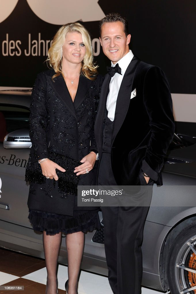 Corinna and <a gi-track='captionPersonalityLinkClicked' href=/galleries/search?phrase=Michael+Schumacher&family=editorial&specificpeople=157602 ng-click='$event.stopPropagation()'>Michael Schumacher</a> attend the GQ Men Of The Year 2010 award ceremony at Komische Oper on October 29, 2010 in Berlin, Germany.