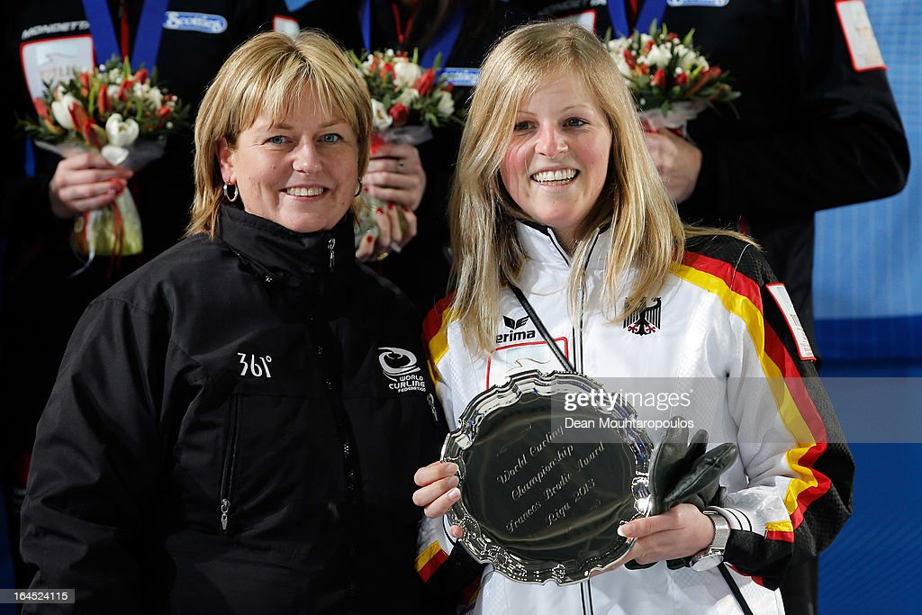 Corinna Scholz (R) of Germany poses with her Frances Brodie Award for Sportsmanship on Day 9 of the Titlis Glacier Mountain World Women's Curling Championship at the Volvo Sports Centre on March 24, 2013 in Riga, Latvia.