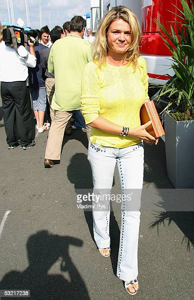 Corinna Schumacher walks in the paddock after the Qualifying for the British F1 Grand Prix on July 9 2005 in Silverstone England