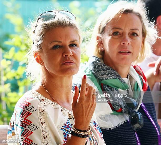 Corinna Schumacher wife of former German Formula One driver Michael Schumacher watches their daughter Gina present the elements of the reining...