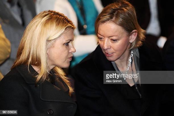 Corinna Schumacher wife of seventime world Formula One world champion Michael Schumacher chats with Schumacher's press officer Sabine Kehm during the...