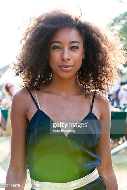 Corinne Bailey Rae posing in the Hard Rock Cafe backstage VIP area on day two of Hard Rock Calling in Hyde Park on June 26 2010 in London England
