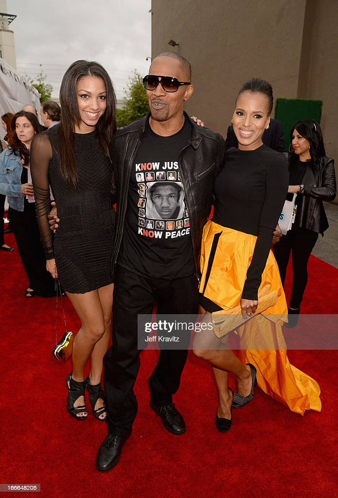 Corinne Bishop, actor Jamie Foxx, and actress Kerry Washington attend the 2013 MTV Movie Awards at Sony Pictures Studios on April 14, 2013 in Culver City, California.