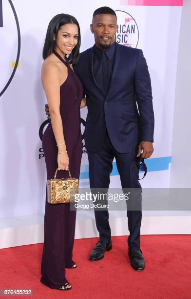 Corinne Foxx and Jamie Foxx arrive at the 2017 American Music Awards at Microsoft Theater on November 19 2017 in Los Angeles California
