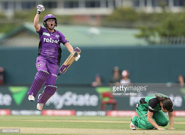Corinne Hall of the Hurricanes celebrates scoring the winning runs as Gemma Triscari of the Melbourne Stars looks dejected during the Women's Big...