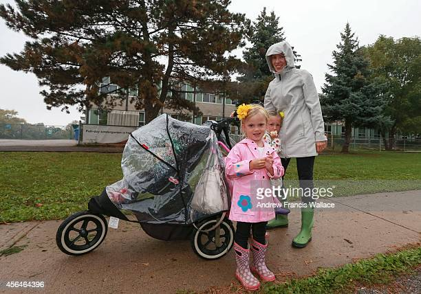 Corinne Moore poses with her children outside Pineland Public School in Burlington September 30 2014 Halton board is voting to change boundaries of a...