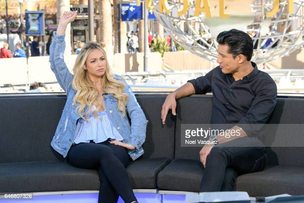 Corinne Olympios and Mario Lopez visit 'Extra' at Universal Studios Hollywood on March 1 2017 in Universal City California