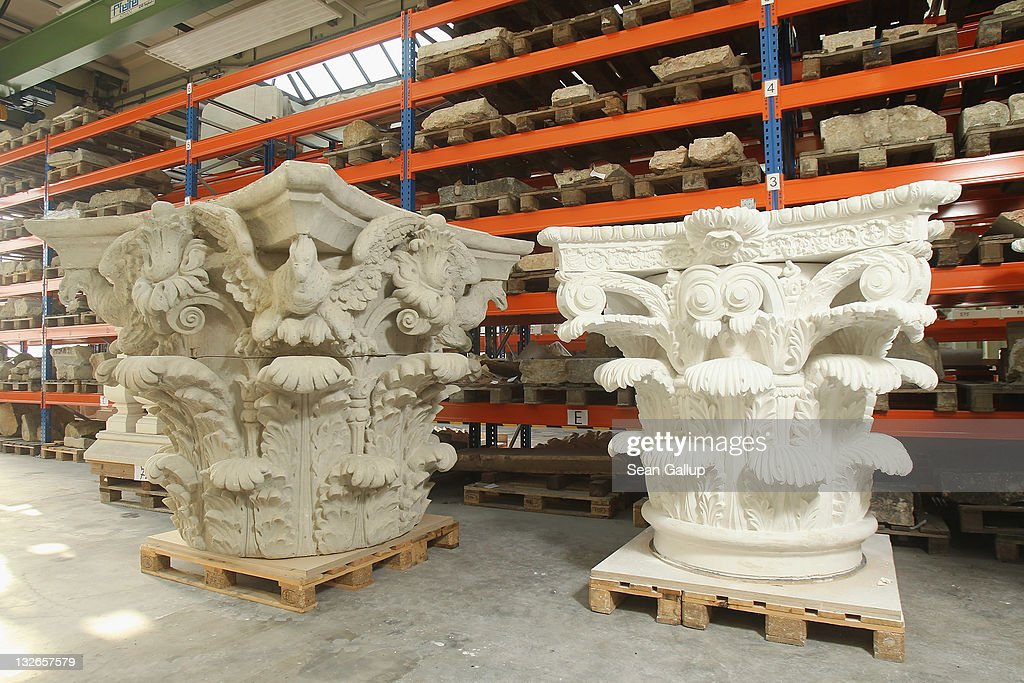 A Corinthian capital made of clay (L) and one cast in plaster stand among other architectural elements stacked at the Schlossbauhuette studio where a team of sculptors is creating decorative elements for the facade of the Berliner Schloss city palace on November 11, 2011 in Berlin, Germany. The Berliner Schloss was the residence of the Prussian Kaiser and was among the major architectural landmarks of Berlin until it was heavily damaged by Allied bombing in 1945. The communist authorities of East Berlin demolished the building in the 1950s, and today's Berlin government is pursuing an ambitious project to rebuild the palace according to a design by Italian architect Franco Stella, which will recreate the facade of the building but with a modern interior at a cost of approximately EUR 590 million. The Humboldt Forum, the foundation leading the project, has given the Schlossbauhuette sculptors the formidable task of recreating the hundreds of architectural elements that decorated the facade, and though some original pieces were saved, more often the sculptors have only old black and white photos as reference.