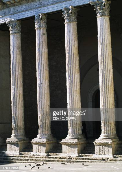 Corinthian columns of the Temple of St Mary above Minerva Assisi Umbria Italy