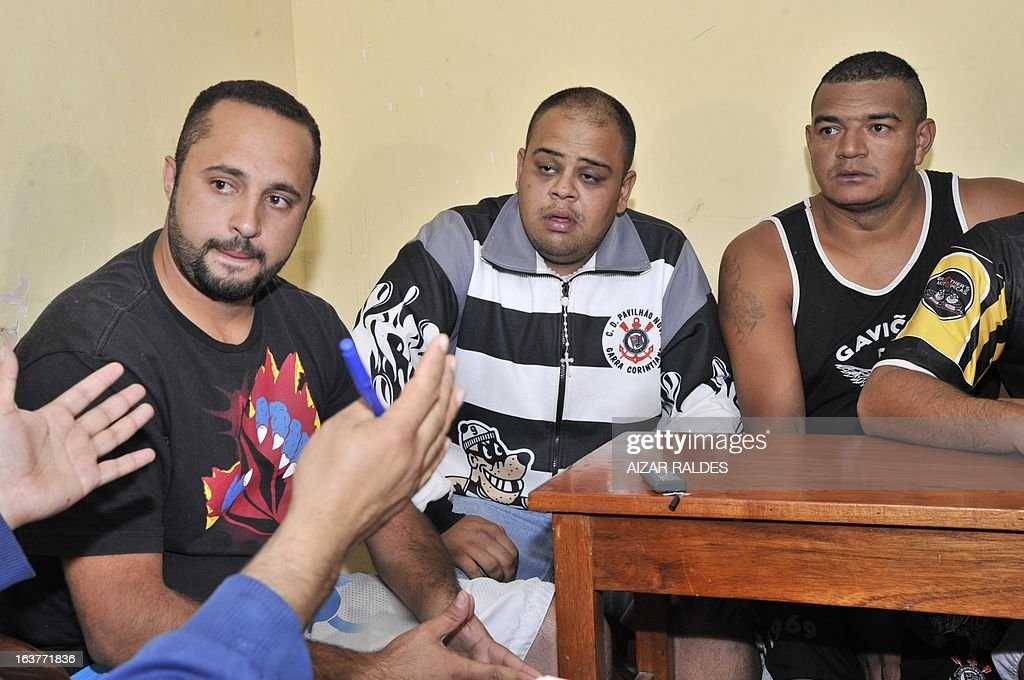 Corinthian fans (L to R) Tadeo De Macedo Andrade, Thiago Aurelio Do Santos and Reginaldo Coelho are depicted at San Pedro jail in Oruro, 240 km from La Paz, on March 15, 2013. The Brazilian supporters are being kept under custody on charges of having taken part in the murder of San Jose de Beltran's supporter Kevin Beltran during the San Jose de Beltran vs Corinthians Libertadores Cup match on February 20, 2013. AFP PHOTO/Aizar Raldes