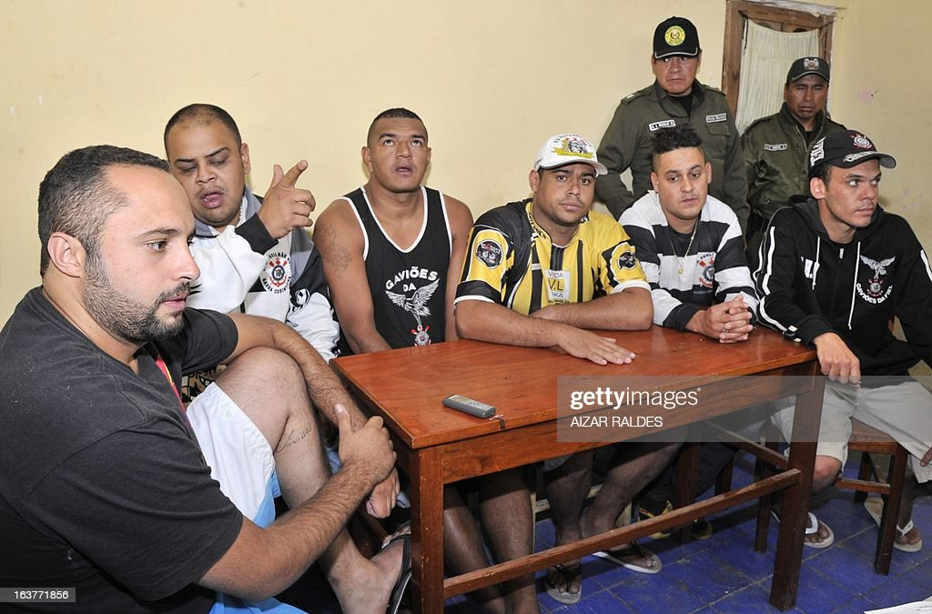 Corinthian fans (L to R) Tadeo De Macedo Andrade, Thiago Aurelio Do Santos, Reginaldo Coelho, Hugo Nonato, Marco Aurelio Nefeire and Fabio Neves Domingo are depicted at San Pedro jail in Oruro, 240 km from La Paz, on March 15, 2013. The Brazilian supporters are being kept under custody on charges of having taken part in the murder of San Jose de Beltran's supporter Kevin Beltran during the San Jose de Beltran vs Corinthians Libertadores Cup match on February 20, 2013. AFP PHOTO/Aizar Raldes