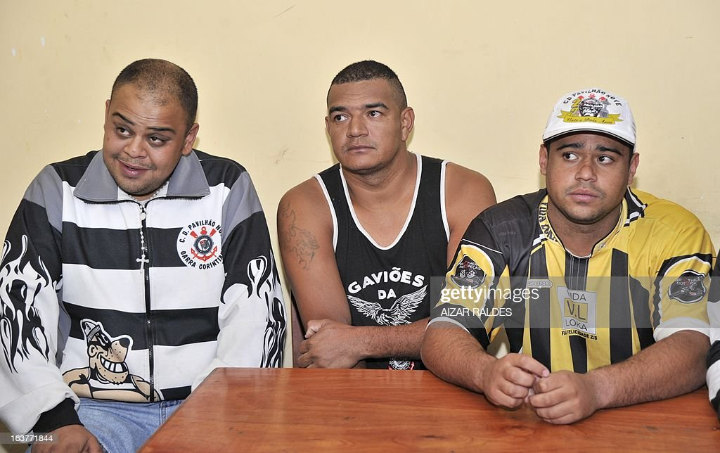 Corinthian fans (L to R) Thiago Aurelio Do Santos, Reginaldo Coelho and Hugo Nonato are depicted at San Pedro jail in Oruro, 240 km from La Paz, on March 15, 2013. The Brazilian supporters are being kept under custody on charges of having taken part in the murder of San Jose de Beltran's supporter Kevin Beltran during the San Jose de Beltran vs Corinthians Libertadores Cup match on February 20, 2013. AFP PHOTO/Aizar Raldes