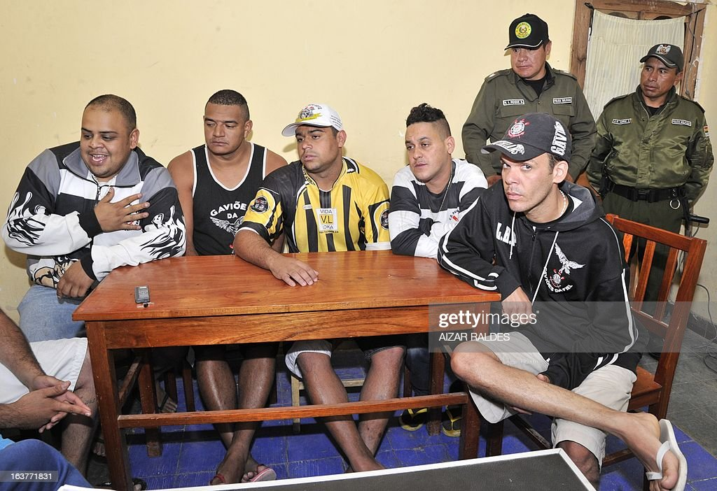 Corinthian fans (L to R) Thiago Aurelio Do Santos, Reginaldo Coelho, Hugo Nonato, Marco Aurelio Nefeire and Fabio Neves Domingo are depicted at San Pedro jail in Oruro, 240 km from La Paz, on March 15, 2013. The Brazilian supporters are being kept under custody on charges of having taken part in the murder of San Jose de Beltran's supporter Kevin Beltran during the San Jose de Beltran vs Corinthians Libertadores Cup match on February 20, 2013. AFP PHOTO/Aizar Raldes