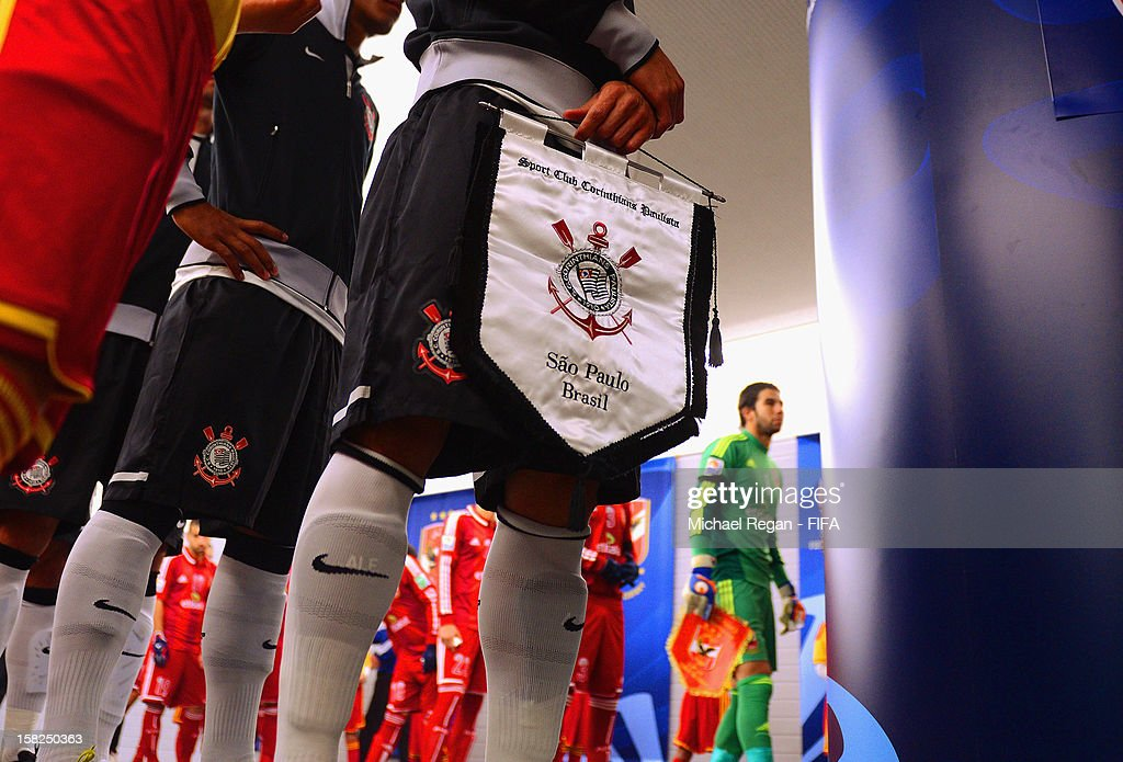 Corinthians captain Alessandro holds a pennant as the teams wait in the tunnel before the FIFA Club World Cup Semi Final match between Al-Ahly SC and Corinthians at Toyota Stadium on December 12, 2012 in Toyota, Japan.