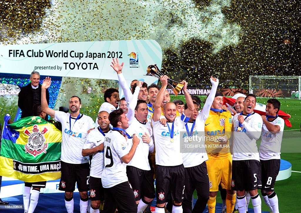 Corinthians captain and defender Alessandro (front C) raises the winning trophy with his teammates during the awarding ceremony of the 2012 Club World Cup football in Yokohama on December 16, 2012. Copa Libertadores Champion Corinthians beat English premier league team Chelsea FC 1-0 to get the title.