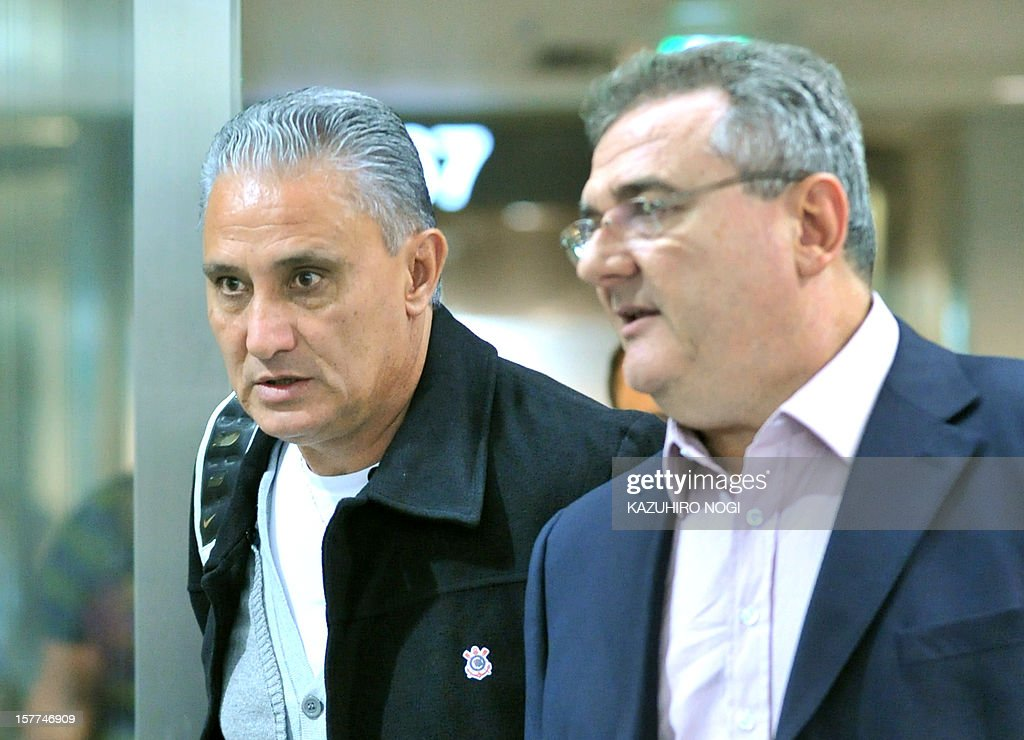 Corinthians football head coach Tite (L) arrives for the Club World Cup at Narita airport on December 6, 2012.