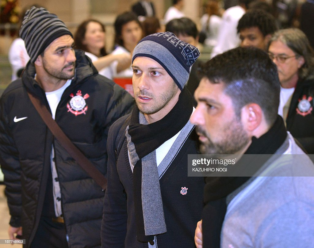 Corinthians football players Alessandro (C), midfielder Danilo (L) and their teammates arrive for the Club World Cup at Narita airport on December 6, 2012.