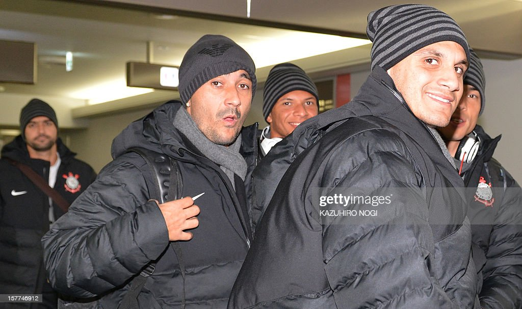 Corinthians football players Fabio Santos, midfileder Douglas (C) and their teammates arrive for the Club World Cup at Narita airport on December 6, 2012.