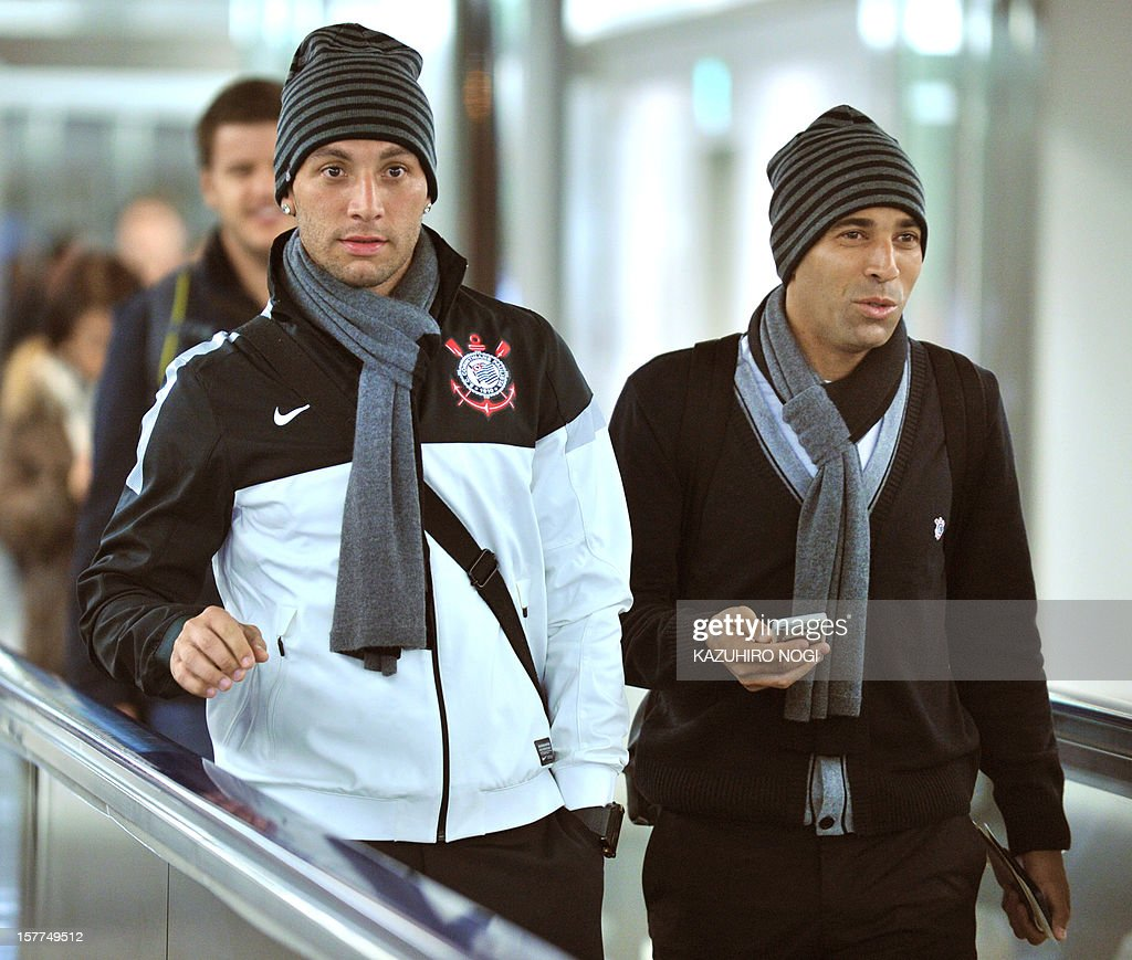 Corinthians football players, Guilherme Andrade (L) and Emerson (R) arrive for the Club World Cup at Narita airport on December 6, 2012.