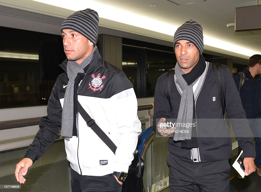 Corinthians football players Guilherme Andrade (L) and Emerson (R) arrive for the Club World Cup at Narita airport on December 6, 2012.