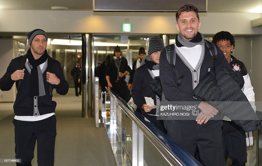 Corinthians football players Paulo Andre (R), Alessandro (L) and their teammates arrive for the Club World Cup at Narita airport on December 6, 2012.
