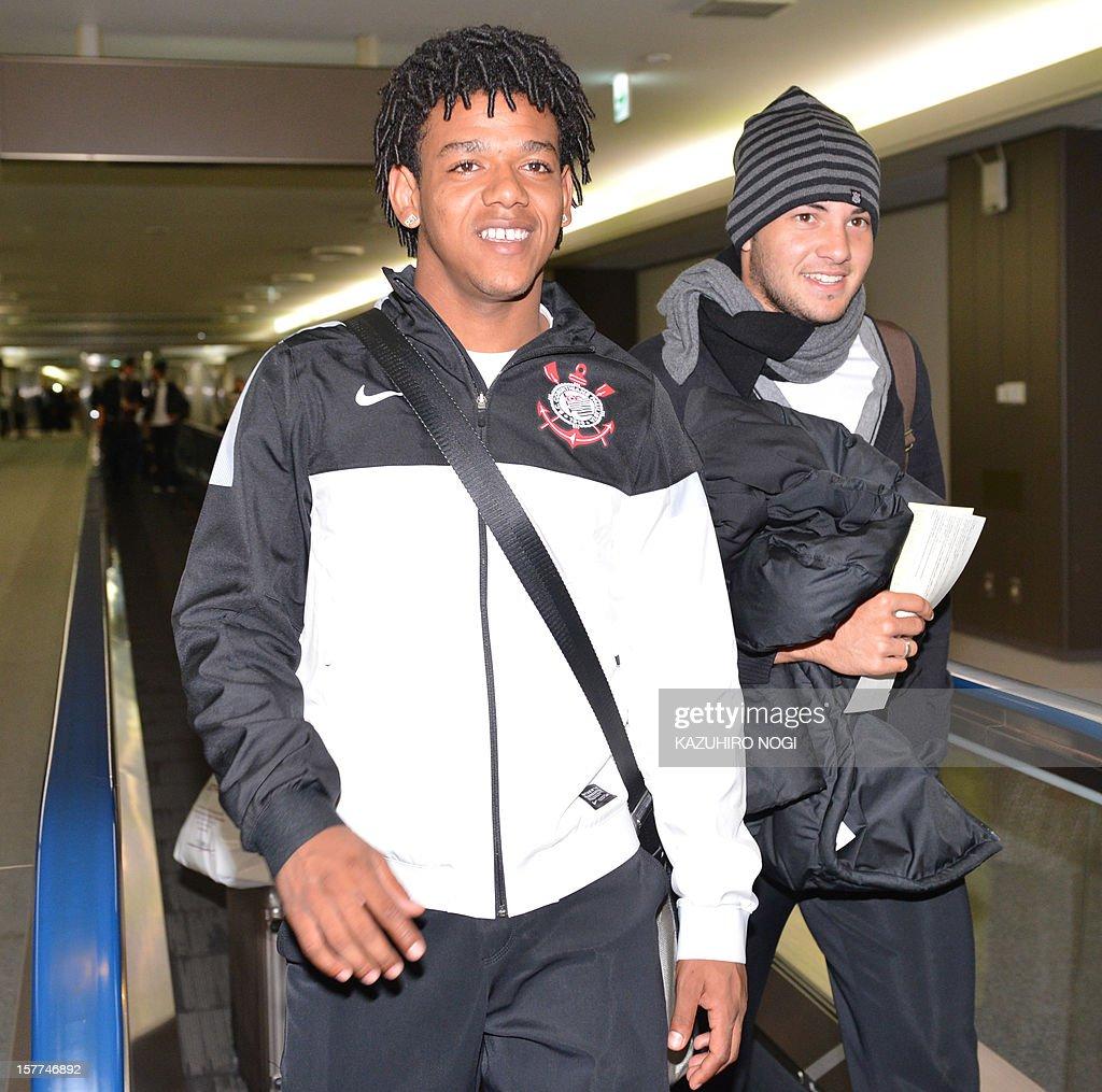 Corinthians football players Romarinho (L) and Giovanni (R) arrive for the Club World Cup at Narita airport on December 6, 2012. AFP PHOTO / KAZUHIRO NOGI