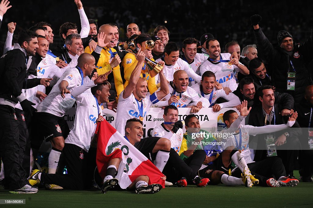 Corinthians players celebrate their win with the champions board after the FIFA Club World Cup Final Match between Corinthians and Chelsea at International Stadium Yokohama on December 16, 2012 in Yokohama, Japan.