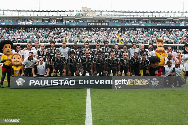 Corinthians players pose for photographers before their 2013 Paulista championship final football match against Santos at Vila Belmiro stadium in...