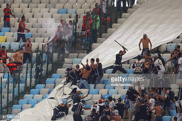 Corinthians's fans fight with police before a match between Flamengo and Corinthians as part of Brasileirao Series A 2016 at Maracana stadium on...