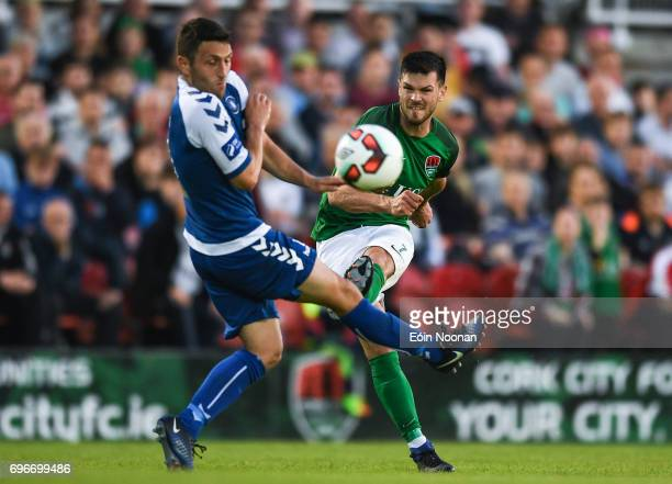 Cork Ireland 16 June 2017 Jimmy Keohane of Cork City scoring his side's fourth goal despite the efforts of Shane Duggan of Limerick during the SSE...