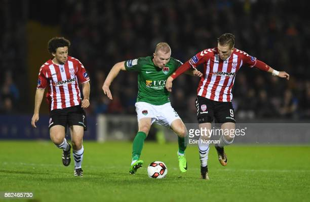 Cork Ireland 17 October 2017 Stephen Dooley of Cork City in action against Barry McNamee left and Ronan Curtis of Derry City during the SSE...