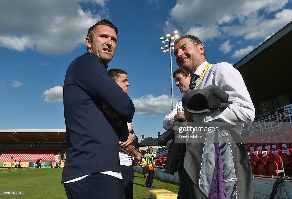 Cork , Ireland - 31 May 2016; <a gi-track='captionPersonalityLinkClicked' href=/galleries/search?phrase=Robbie+Keane&family=editorial&specificpeople=171824 ng-click='$event.stopPropagation()'>Robbie Keane</a>, left, of Republic of Ireland in conversation with former Republic of Ireland International <a gi-track='captionPersonalityLinkClicked' href=/galleries/search?phrase=Denis+Irwin&family=editorial&specificpeople=221637 ng-click='$event.stopPropagation()'>Denis Irwin</a> before the start of the EURO2016 Warm-up International between Republic of Ireland and Belarus in Turners Cross, Cork.
