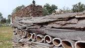 Many pieces of bark, detached from cork oaks, natural raw material, ready for transportation und further processing. Portugal, Alentejo, near Mertola